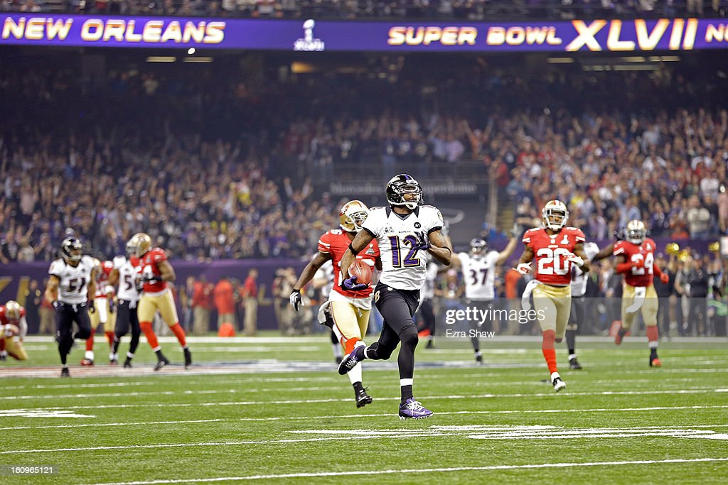 Jacoby Jones #12 of the Baltimore Ravens returns the opening kick-off for the second half 108-yards for a touchdown against the San Francisco 49ers during Super Bowl XLVII at the Mercedes-Benz Superdome on February 3, 2013 in New Orleans, Louisiana. The Ravens won 34-31.