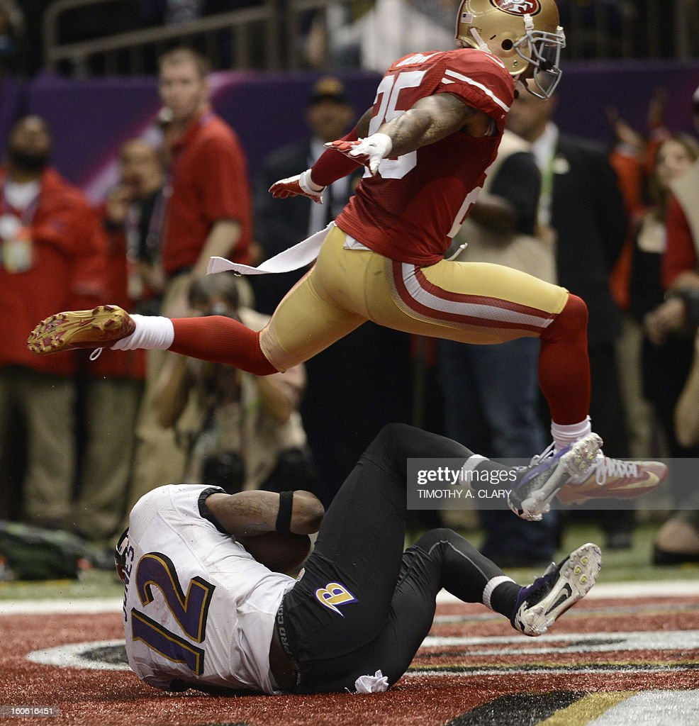 Jacoby Jones (BOTTOM) of the Baltimore Ravens scores a touchdown before Tarell Brown (TOP) of the San Francisco 49ers during Super Bowl XLVII at the Mercedes-Benz Superdome on February 3, 2013 in New Orleans, Louisiana.