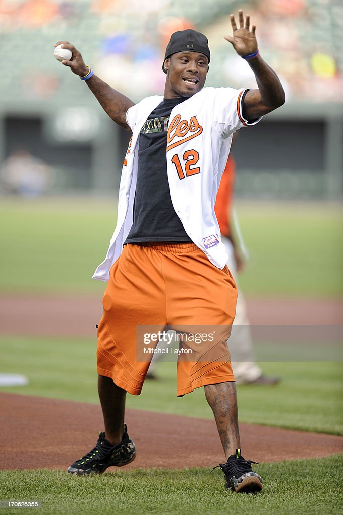 Jacoby Jones of the Baltimore Ravens throws out the first pitch before a baseball game between the Baltimore Orioles and the Boston Red Sox on June 15, 2013 at Oriole Park at Camden Yards in Baltimore, Maryland.