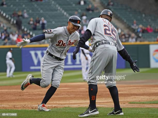 JaCoby Jones of the Detroit Tigers celebrtaes his three run home run in the 2nd inning with third base coach Dave Clark during the opening day game...