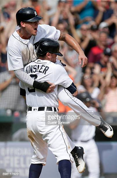 JaCoby Jones of the Detroit Tigers jumps into the arms of Ian Kinsler of the Detroit Tigers after scoring the winning run against the Chicago White...