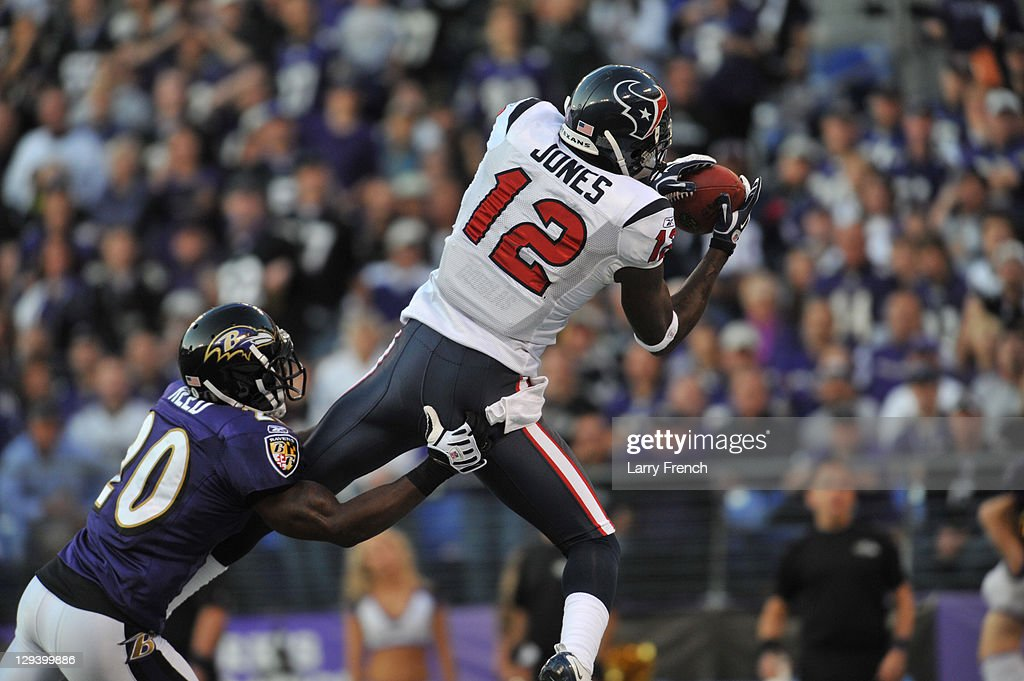 Jacoby Jones #24 of the Houston Texans catches the ball for a touchdown against the Baltimore Ravens at M&T Bank Stadium on October 16. 2011 in Baltimore, Maryland. The Ravens defeated the Texans 29-14.