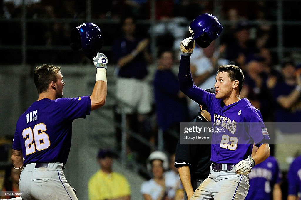 JaCoby Jones #23 of the LSU Tigers greets Ty Ross #26 at home plate following a home run during Game 2 of the NCAA baseball Super Regionals against the Oklahoma Sooners at Alex Box Stadium on June 8, 2013 in Baton Rouge, Louisiana.