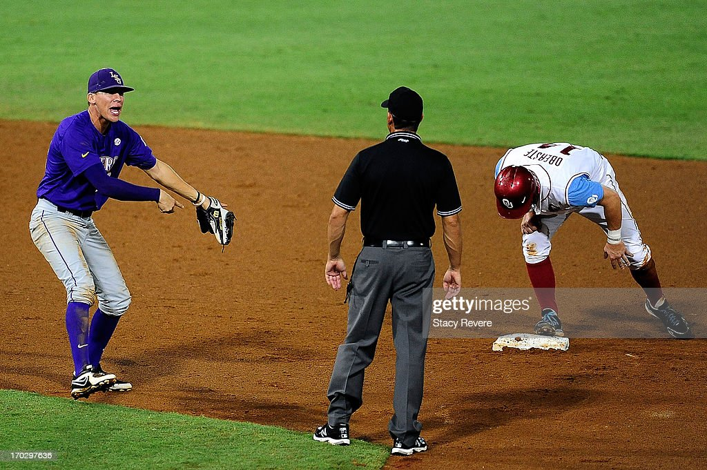 JaCoby Jones #23 of the LSU Tigers reacts to a call by the second base umpire during Game 2 of the NCAA baseball Super Regionals against the Oklahoma Sooners at Alex Box Stadium on June 8, 2013 in Baton Rouge, Louisiana.