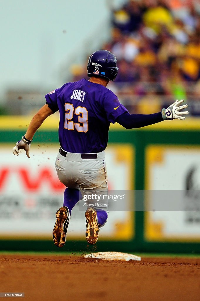 JaCoby Jones #23 of the LSU Tigers slides into second base during Game 2 of the NCAA baseball Super Regionals against the Oklahoma Sooners at Alex Box Stadium on June 8, 2013 in Baton Rouge, Louisiana.
