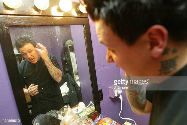Jacoby Shaddix of Papa Roach fixes his hair prior to the band's performance at the Warfield in San Francisco