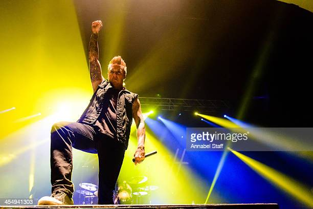 Jacoby Shaddix of Papa Roach performs on stage at Brixton Academy on December 10 2013 in London United Kingdom