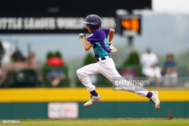 Jacopo Borella of the Europe Africa team from Italy runs to third base during Game 3 of the 2017 Little League World Series against the Canada team...