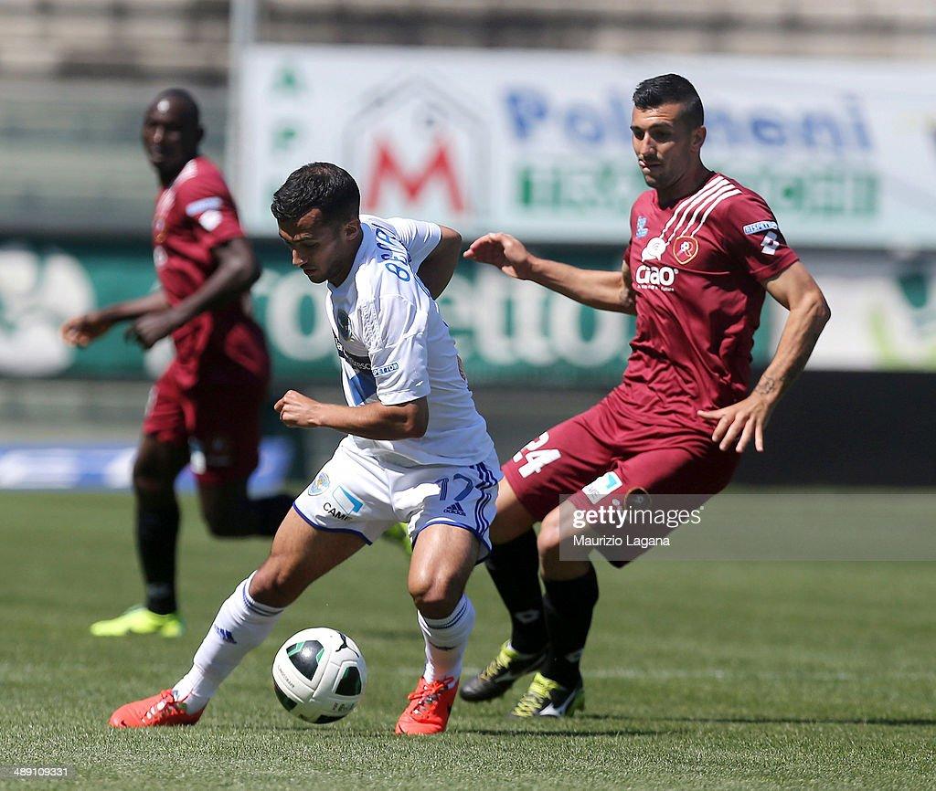 Jacopo Dall'Oglio (R) of Reggina competes for the ball with Ahmad Benali of Brescia during the Serie B match between Reggina Calcio and Brescia Calcio on May 10, 2014 in Reggio Calabria, Italy.