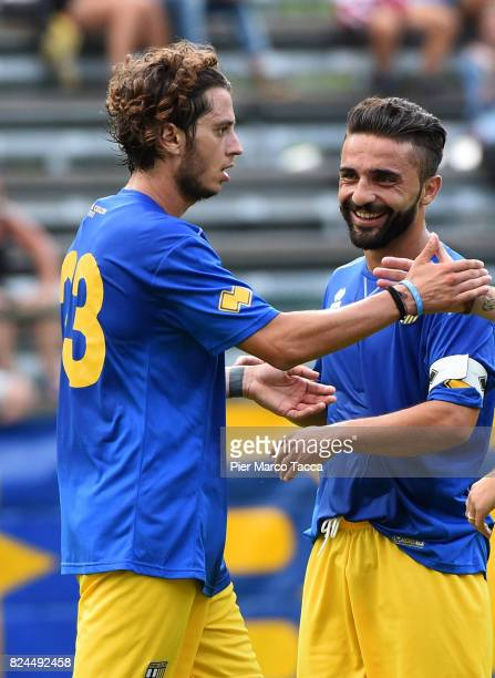Jacopo Dezi celebrates with his teamate during the preseason friendly match between Parma Calcio and Dro on July 30 2017 in Pinzolo near Trento Italy
