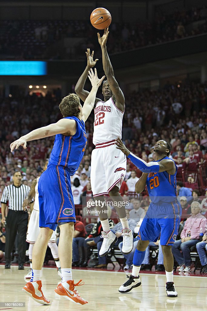 Jacorey Williams #22 of the Arkansas Razorbacks shoots a jump shot over Erik Murphy #33 of the Florida Gators at Bud Walton Arena on February 5, 2013 in Fayetteville, Arkansas. The Razorbacks defeated the Gators 80-69.