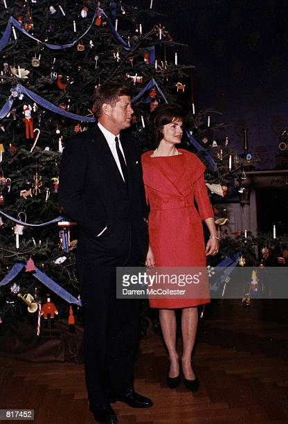 Jacqeuline Kennedy and her husband President John F Kenndy attend the White House staff Christmas Party December 31 1961 in Washington DC