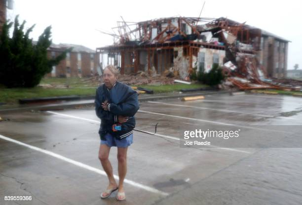 Jacque McKay walks through the apartment complex where she lives and road out the storm after Hurricane Harvey destroyed many of the apartments on...