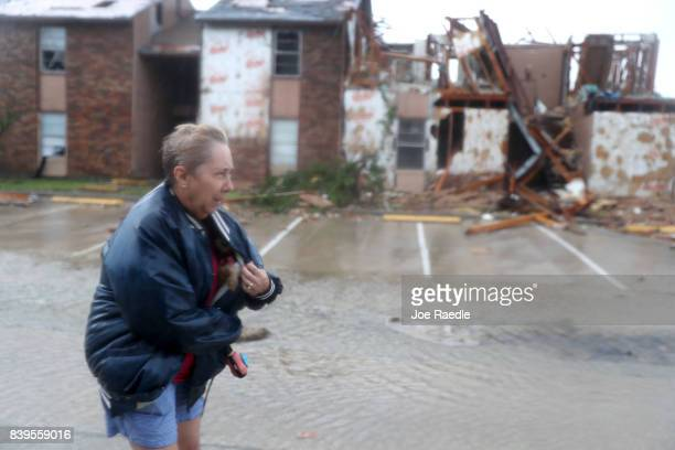 Jacque McKay walks through the apartment complex where she lives with her dog and road out the storm after Hurricane Harvey destroyed many of the...