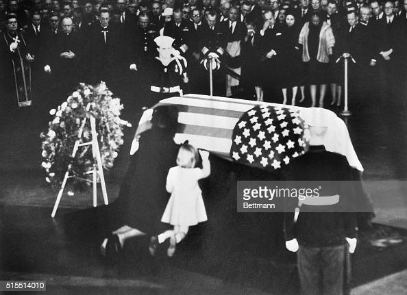 Jacqueline and Caroline Kennedy wife and daughter of assassinated president John F Kennedy kneel at his coffin
