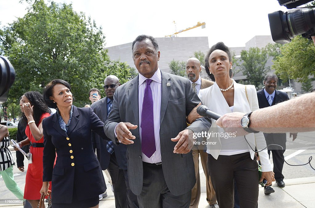 Jacqueline Brown, Rev. Jesse Jackson and Jacqueline Lavinia walk away from a press conference outside the E. Barrett Prettyman United States Court House after his son former Rep. Jesse Jackson Jr. and his wife Sandi Jackson were sentenced for using $750,000 in campaign money to pay for living expense, clothing and luxury items on August 14, 2013 in Washington, DC. The former Illinois congressman was sentenced to 30 months in prision and his wife received a 12-month prison term.