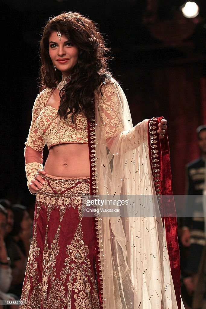 <a gi-track='captionPersonalityLinkClicked' href=/galleries/search?phrase=Jacqueline+Fernandez&family=editorial&specificpeople=5749256 ng-click='$event.stopPropagation()'>Jacqueline Fernandez</a> showcases designs by Anju Modi during day 1 of Lakme Fashion Week Winter/Festive 2014 at The Palladium Hotel on August 20, 2014 in Mumbai, India.
