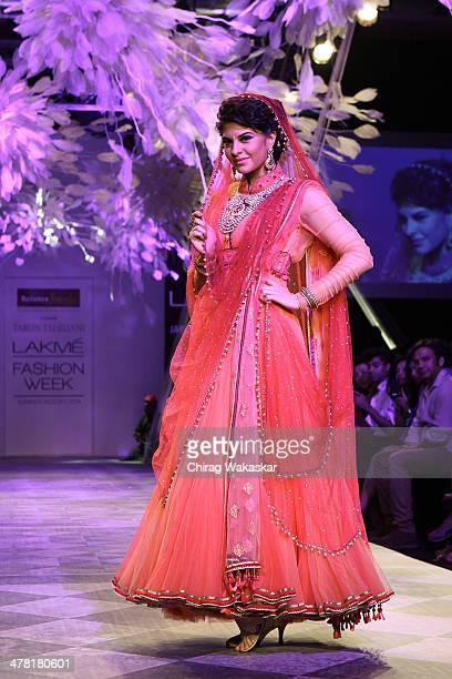 Jacqueline Fernandez walks the runway wearing designs by Tarun Tahiliani at day 2 of Lakme Fashion Week Summer/Resort 2014 at the Grand Hyatt on...