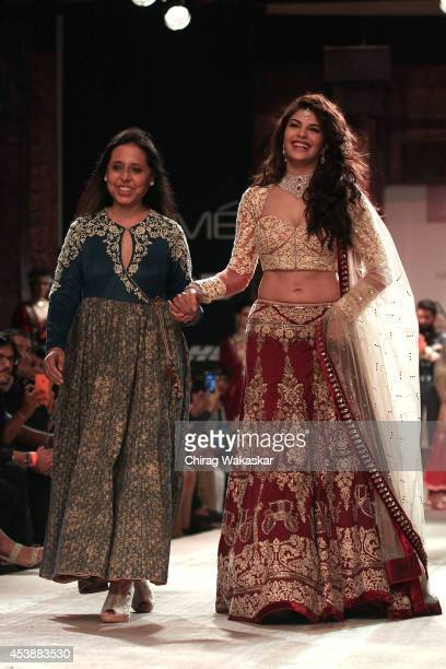 Jacqueline Fernandez walks the runway with Anju Modi during day 1 of Lakme Fashion Week Winter/Festive 2014 at The Palladium Hotel on August 20 2014...