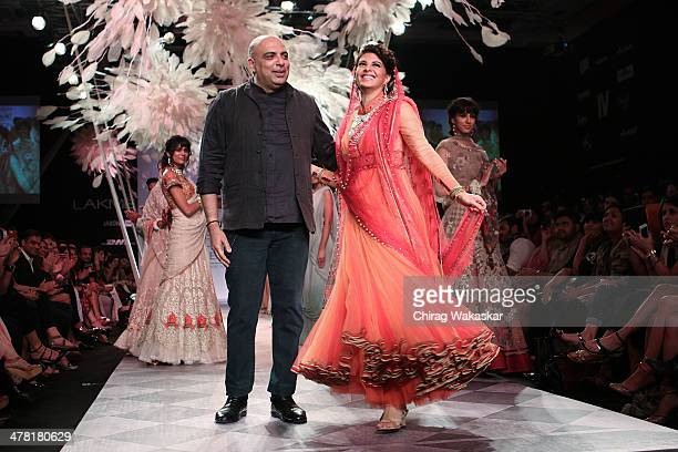 Jacqueline Fernandez walks the runway with Tarun Tahiliani at day 2 of Lakme Fashion Week Summer/Resort 2014 at the Grand Hyatt on March 12 2014 in...