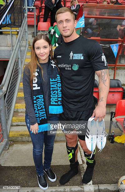 Jacqueline Jossa and Dan Osborne attend the Men United XI v Leyton Orient Legends charity football match at the Matchroom Stadium on May 31 2015 in...