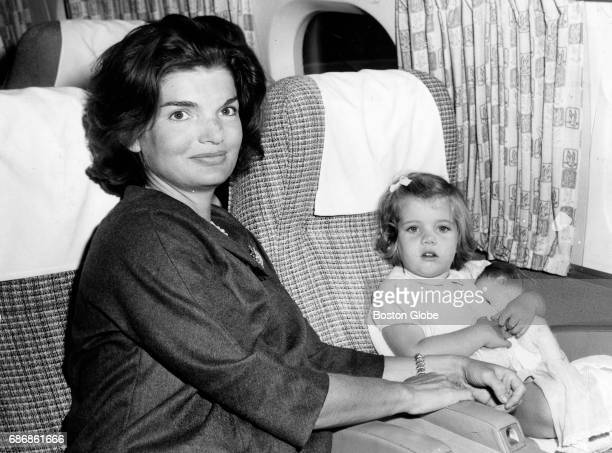 Jacqueline Kennedy and her daughter Caroline Kennedy sit on a plane for Washington DC at Logan International Airport in Boston on Oct 2 1960