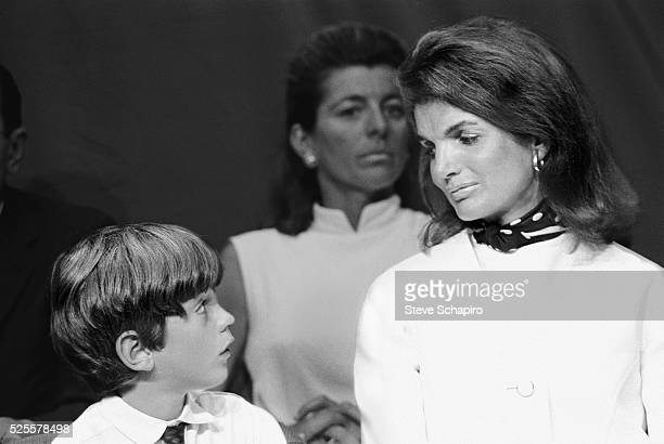 Jacqueline Kennedy and son John Jr at the dedication ceremony of the USS John F Kennedy aircraft carrier