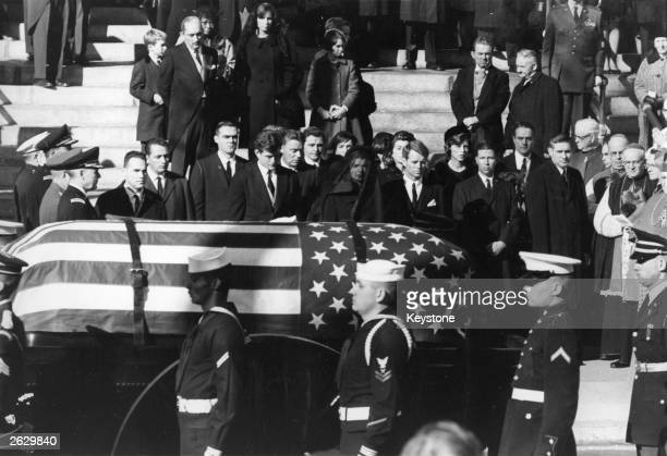 Jacqueline Kennedy Edward Kennedy and Robert Kennedy stand as the coffin of President John Fitzgerald Kennedy passes them Original Publication People...