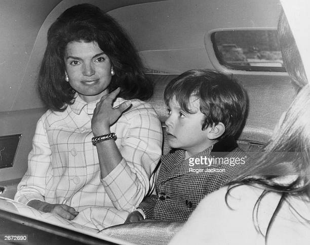 Jacqueline Kennedy in a car with one of her nephews She is stopping over in London on her way home after a visit to Spain