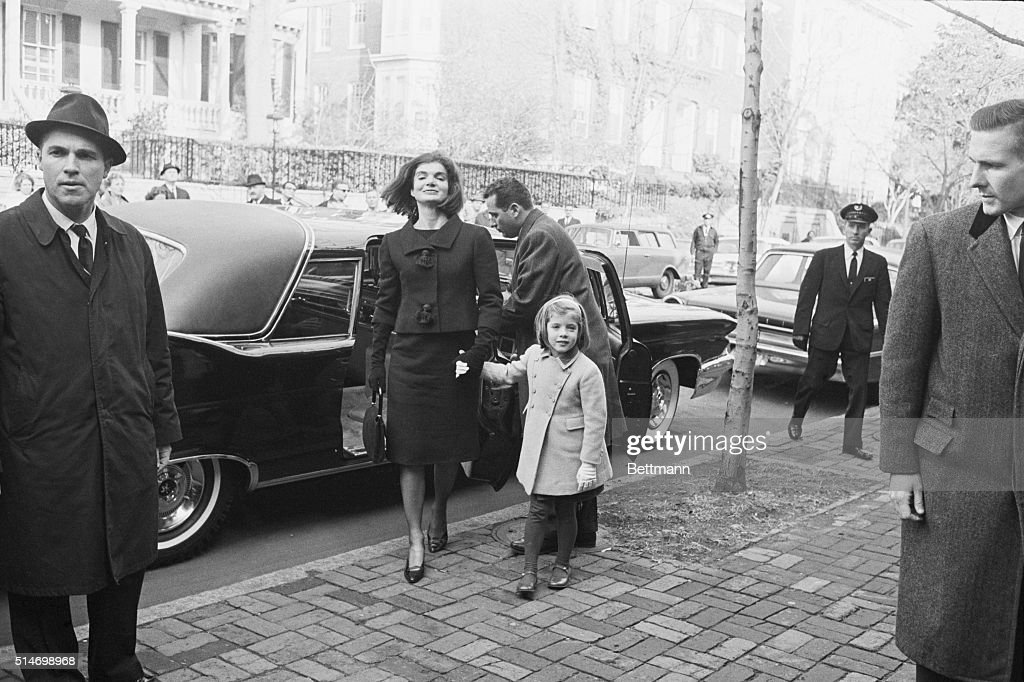 Jacqueline Kennedy leads her daughter, Caroline, into the home of W. Averell Harriman, the Undersecretary of State on December 6, 1963. Harriman offered the Kennedys a home after the president was assassinated, and the First Lady moved from the White Hous