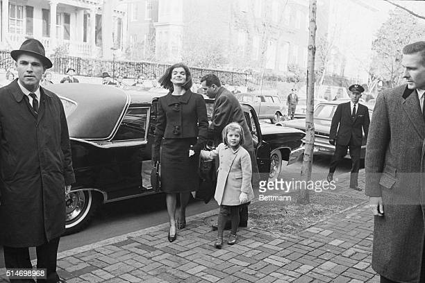 Jacqueline Kennedy leads her daughter Caroline into the home of W Averell Harriman the Undersecretary of State on December 6 1963 Harriman offered...