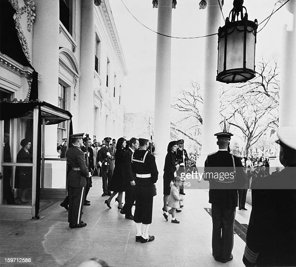 Jacqueline Kennedy leaves the White House with her children Caroline Kennedy and John F Kennedy Jr during the funeral of assassinated president John...