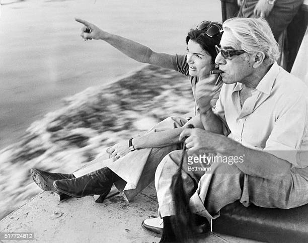 Jacqueline Kennedy Onassis and a cigarsmoking Aristotle Onassis relax along a river during their 10day tour of Egypt