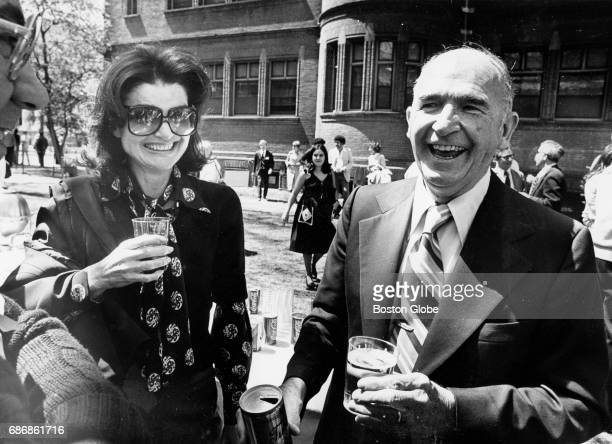 Jacqueline Kennedy Onassis and David Power stand together at a picnic at Harvard University in Cambridge Mass on April 30 1977