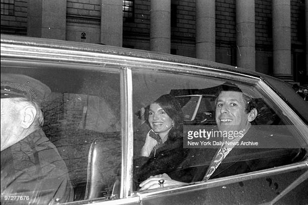 Jacqueline Kennedy Onassis and her lawyer Martin London smile as they leave Federal Court where she was engaged in a legal skirmish with freelance...