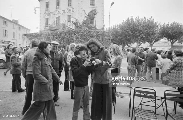 Jacqueline Kennedy Onassis and her son John F Kennedy Jr taking pictures during a holiday in the Camargue region of southern France 5th November 1973...