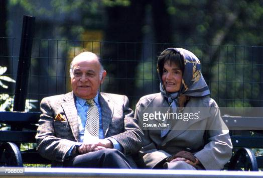 Jacqueline Kennedy Onassis and Maurice Tempelsman sit on a bench at Central Park April 4 1994 in New York City Actor Jerry Adler plays the role of...