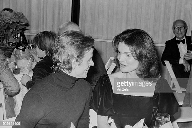 Jacqueline Kennedy Onassis and Mikhail Baryshnikov seated at a table in conversation Mrs Onassis is wearing velvet circa 1970 New York