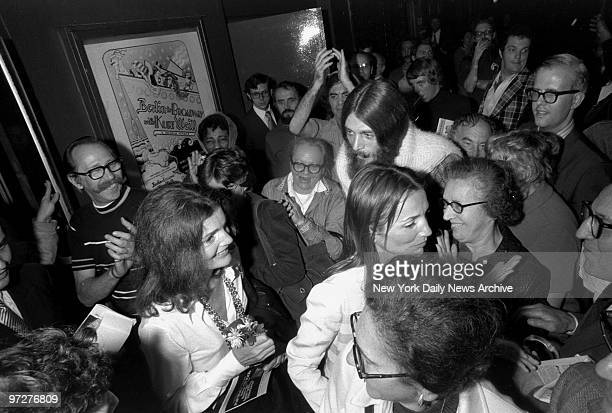 Jacqueline Kennedy Onassis and sister Lee Radziwill plow through crowd after seeing 'Berlin to Broadway'