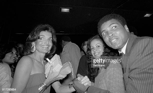 Jacqueline Kennedy Onassis greets world heavyweight boxing champ Muhammad Ali and his wife Veronica as they meet at a party at the Rainbow Room...