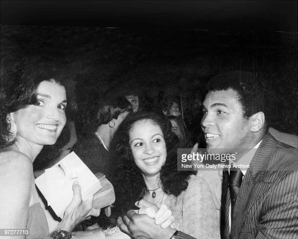Jacqueline Kennedy Onassis greets world heavyweight boxing champion Muhammad Ali and his wife Veronica as festivities get under way at Rainbow Room