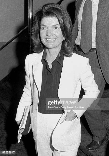 Jacqueline Kennedy Onassis is all aglow at the theater It may be because the performance was benefiting one of her pet philanthropies the East Harlem...