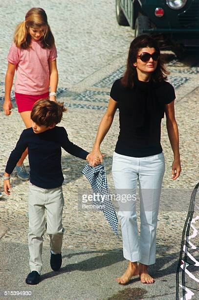 Jacqueline Kennedy widow of president John F Kennedy walks with their children John Jr and Caroline on the day before her wedding to Aristotle...