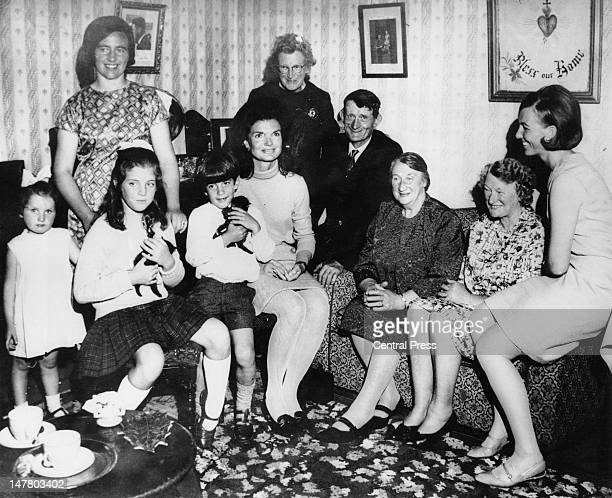 Jacqueline Kennedy with her children Caroline and John in the living room of the Kennedy ancestral home at Dunganstown County Wexford during a family...