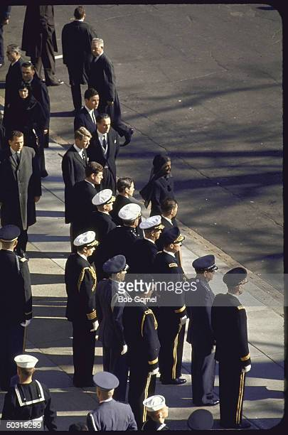 Jacqueline Kennedy with Jamie Auchincloss Sargent Shriver Robert Kennedy Edward Kennedy and Stephen Smith outside St Mathews Cathedral before the...