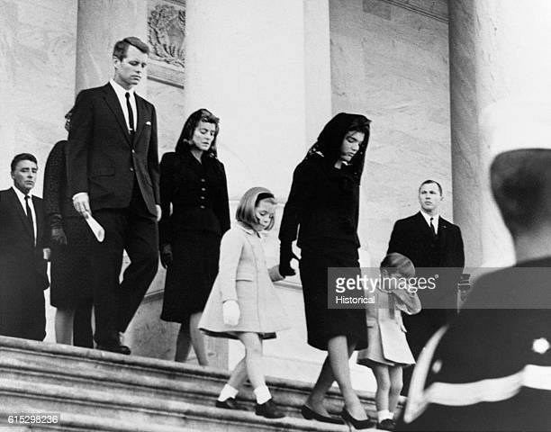 Jacqueline Kennedy with John Jr and Caroline leaves the White House for a service at the Capitol honoring her slain husband President John F Kennedy...