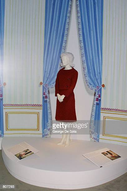 Jacqueline Kennedy wore this dark red wool boucle day dress by Chez Ninon inspired by a Marc Bohan design for Christian Dior on her televised tour of...