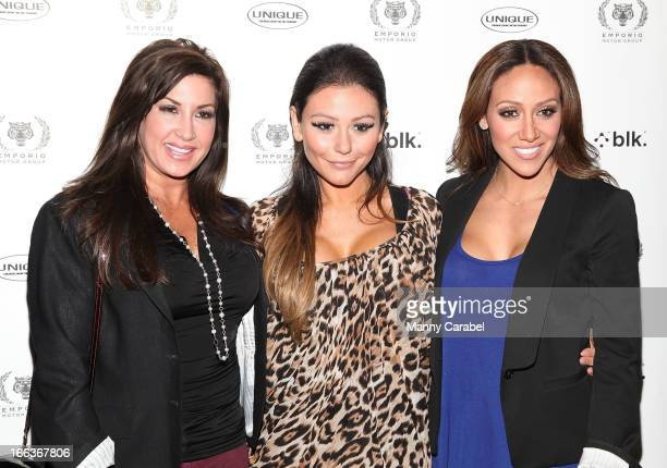 Jacqueline Laurita Jenni 'JWoww' Farley and Melissa Gorga attend the grand opening of the Emporio Motor Group on April 11 2013 in Ramsey New Jersey