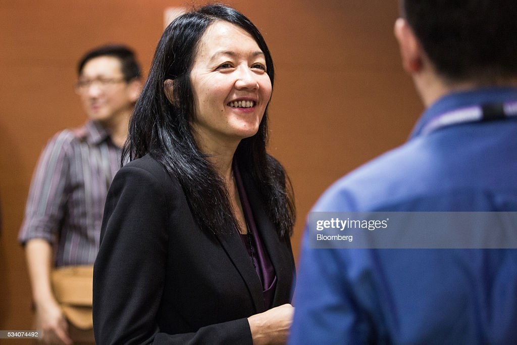 Jacqueline Loh, deputy managing director of the Monetary Authority of Singapore, speaks to members of the media after an economic briefing in Singapore, on Wednesday, May 25, 2016. Singapore's first-quarter economic growth was faster than the government earlier predicted, providing some relief for the trade-oriented nation as it faces sluggish global demand. Photographer: Nicky Loh/Bloomberg via Getty Images