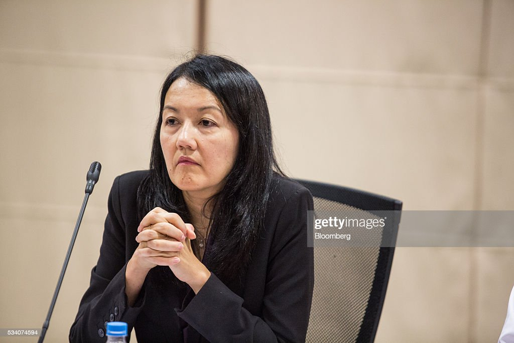 Jacqueline Loh, deputy managing director of the Monetary Authority of Singapore, listens during an economic briefing in Singapore, on Wednesday, May 25, 2016. Singapore's first-quarter economic growth was faster than the government earlier predicted, providing some relief for the trade-oriented nation as it faces sluggish global demand. Photographer: Nicky Loh/Bloomberg via Getty Images